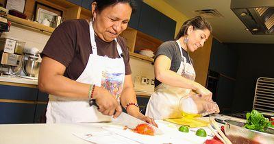 Cooking class facilitators prepping veggies