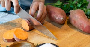Hands Cutting Sweet Potatoes
