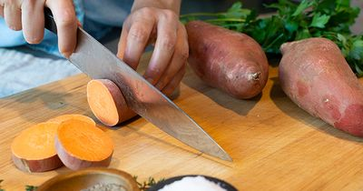 Hands Cutting Sweet Potatoes