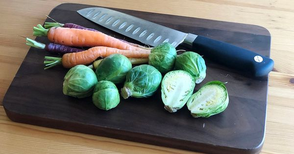 Brussels and Carrots on Cutting Board