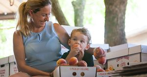 Mary Lightsey and Son with Peaches