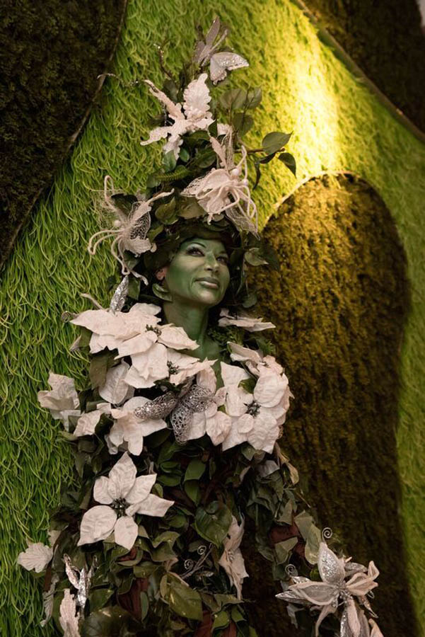 Tree lady in front of live wall.jpg
