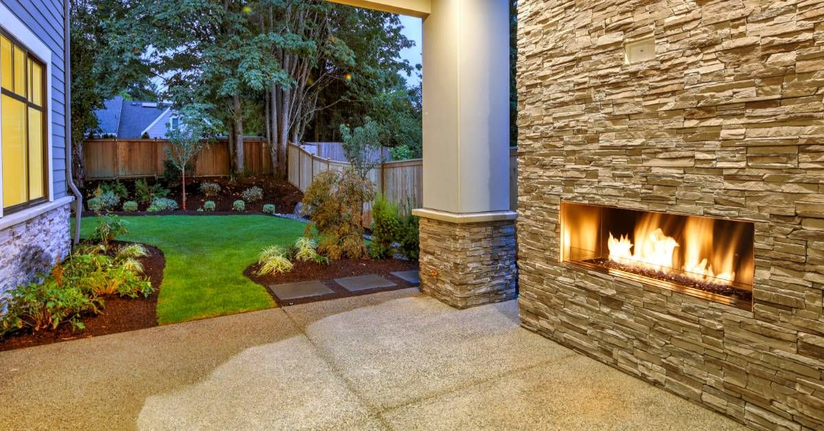 An image of a back yard with a fire pit.