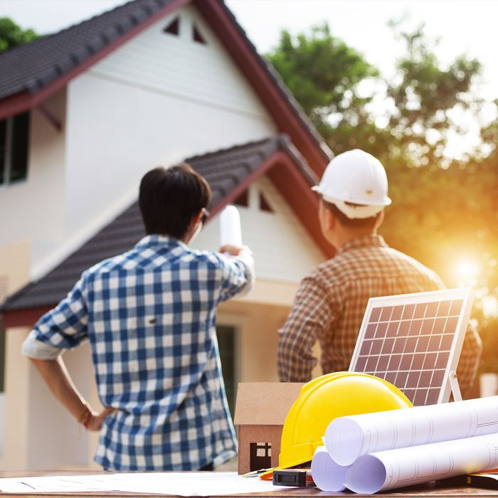 workers planning solar panels for a home