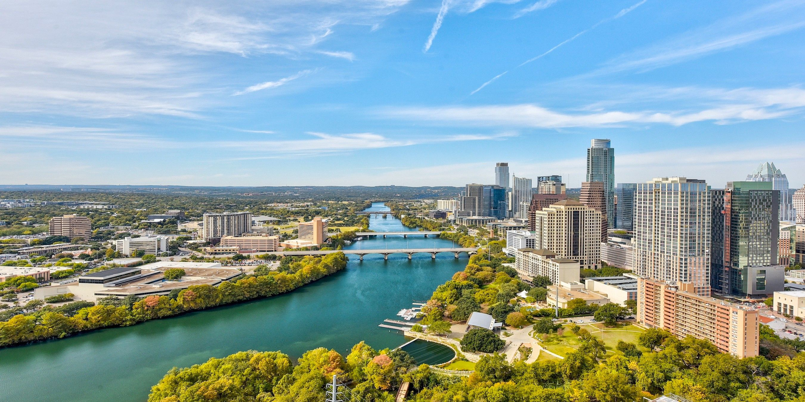Skyline view of Austin and Town Lake from the perspective of a 70 Rainey unit