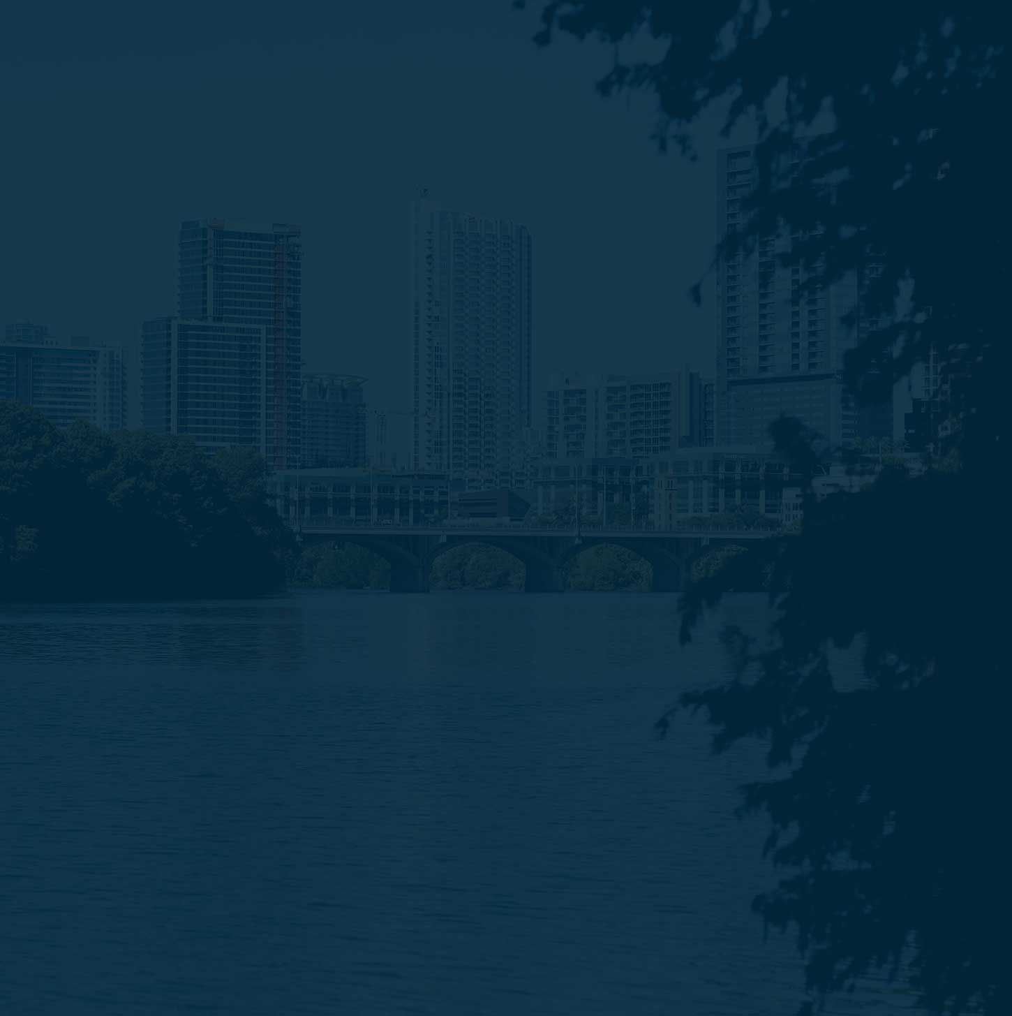 Image of downtown Austin from the perspective of Town Lake with dark blue tinted overlay