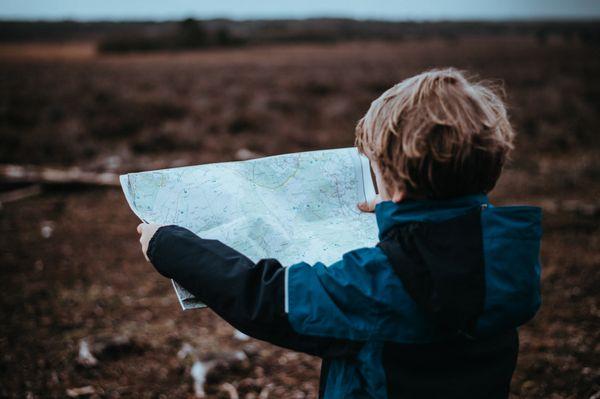 Boy examining a Map (annie-spratt).jpg