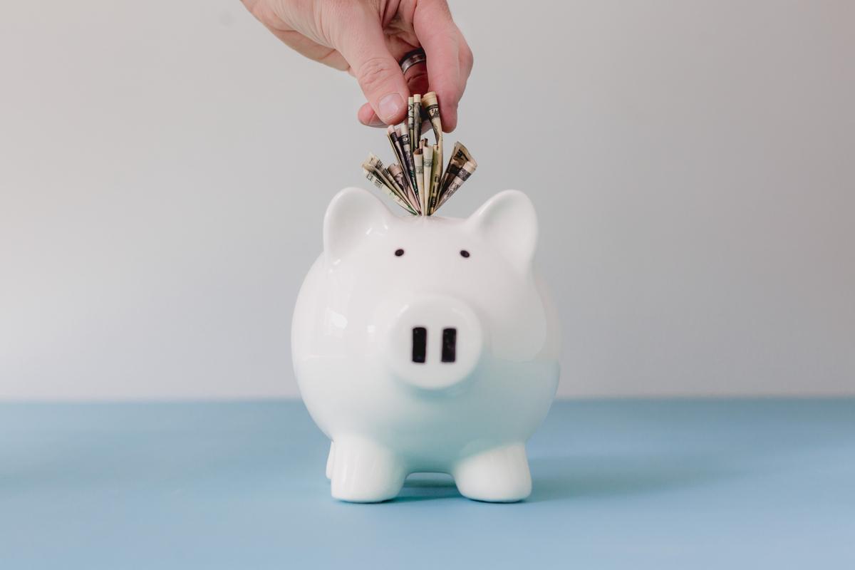 hand-putting-money-in-bank_4460x4460.jpg