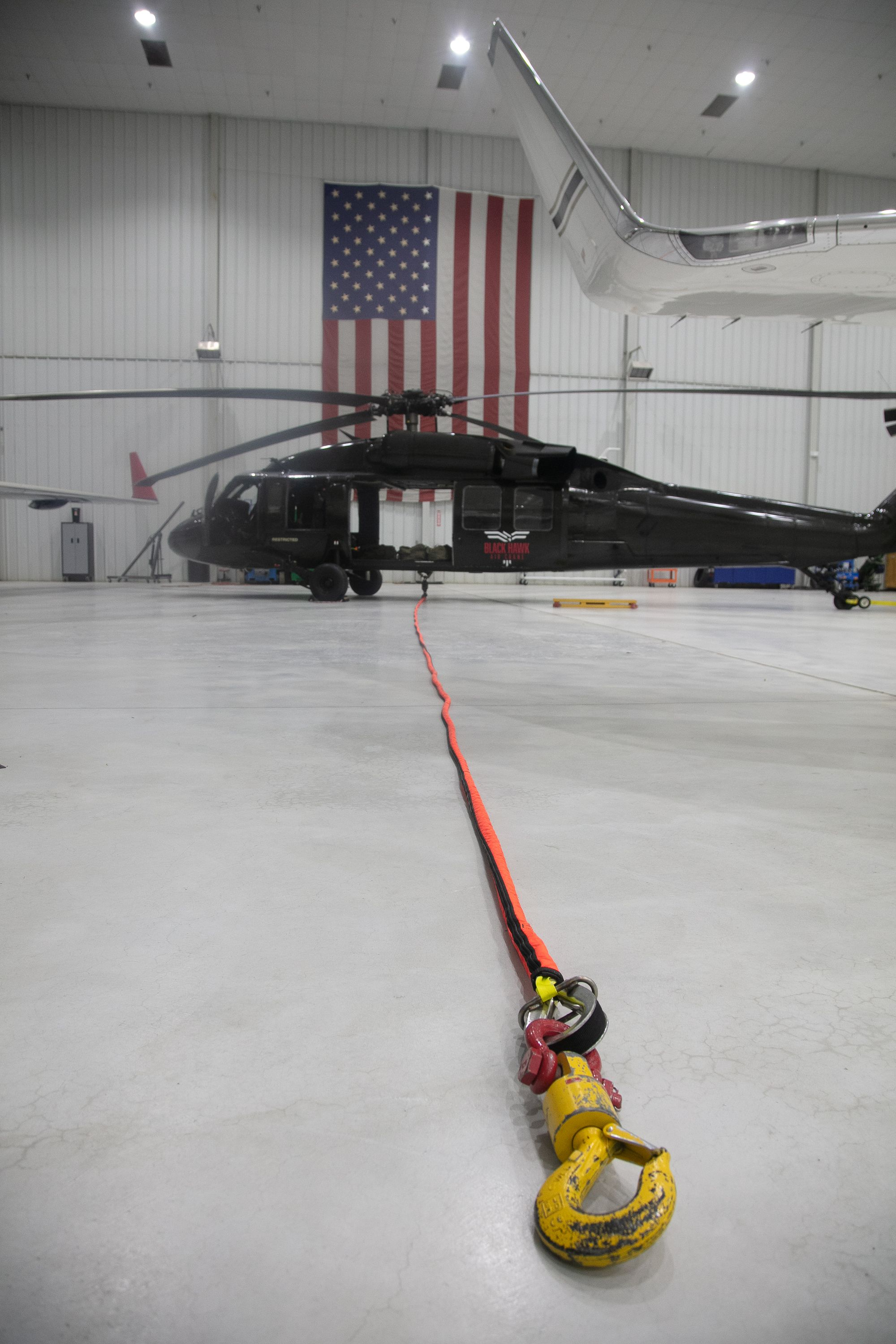black hawk sikorsky uh-60a aerial crane helicopter lifting services