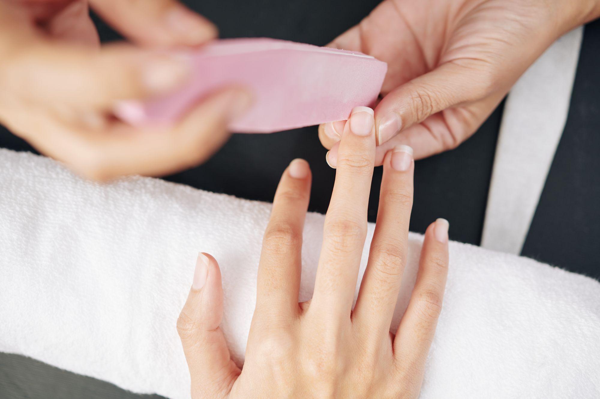 manicurist-filing-nails-DB6UW8L.jpg