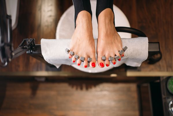 female-client-foot-top-view-pedicure-procedure-5AKSY8C.jpg