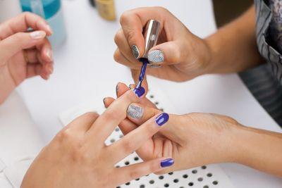close-up-shot-of-a-woman-in-a-nail-salon-receiving-7XG5L9B.jpg