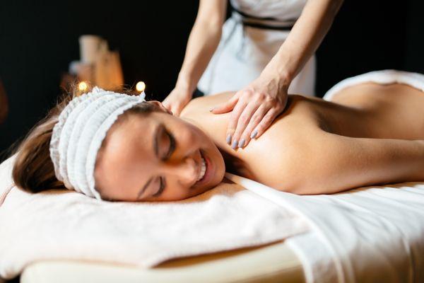 massage-therapist-massaging-woman-HYQ8E3V.jpg