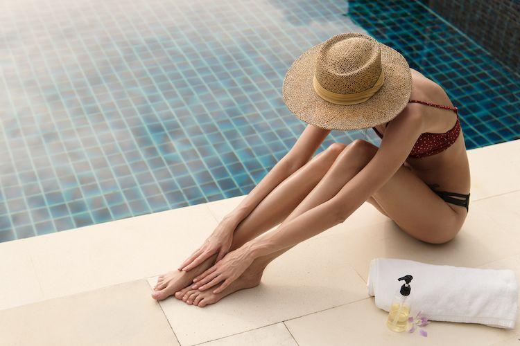 beautiful-tanned-girl-sitting-next-to-a-swimming-p-QCDWPVG.jpg