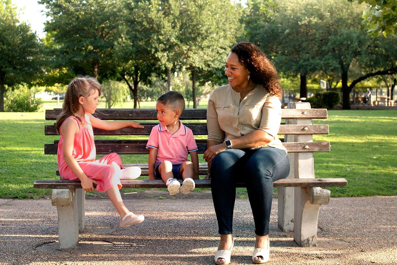 CASA Volunteer and Kids.jpg