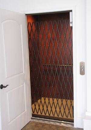 white_elevator_cage_door.jpg
