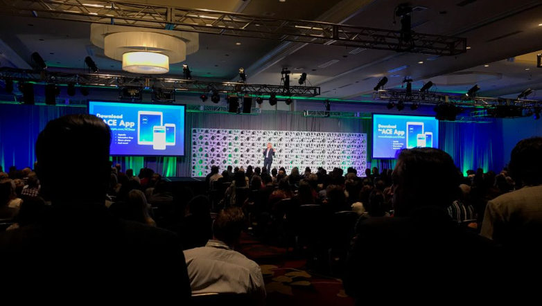A Large Conference Stage with Two Projection Screens