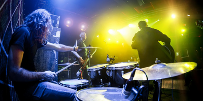 Drummer playing at a concert