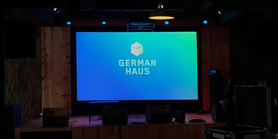 Projection Screen with German Haus Logo on display