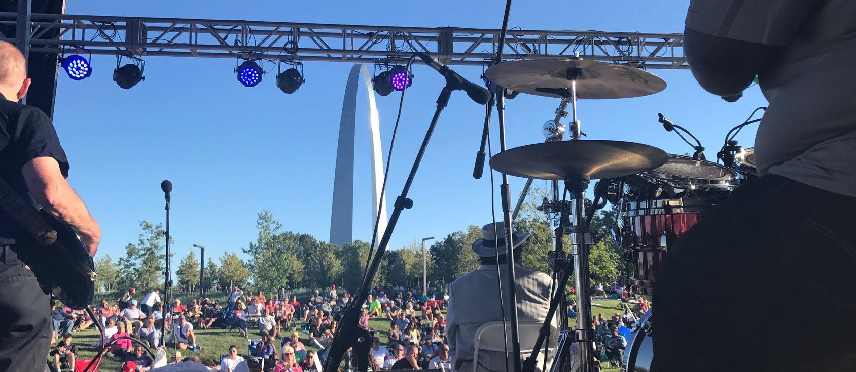 An outdoor concert by the St. Louis Arch