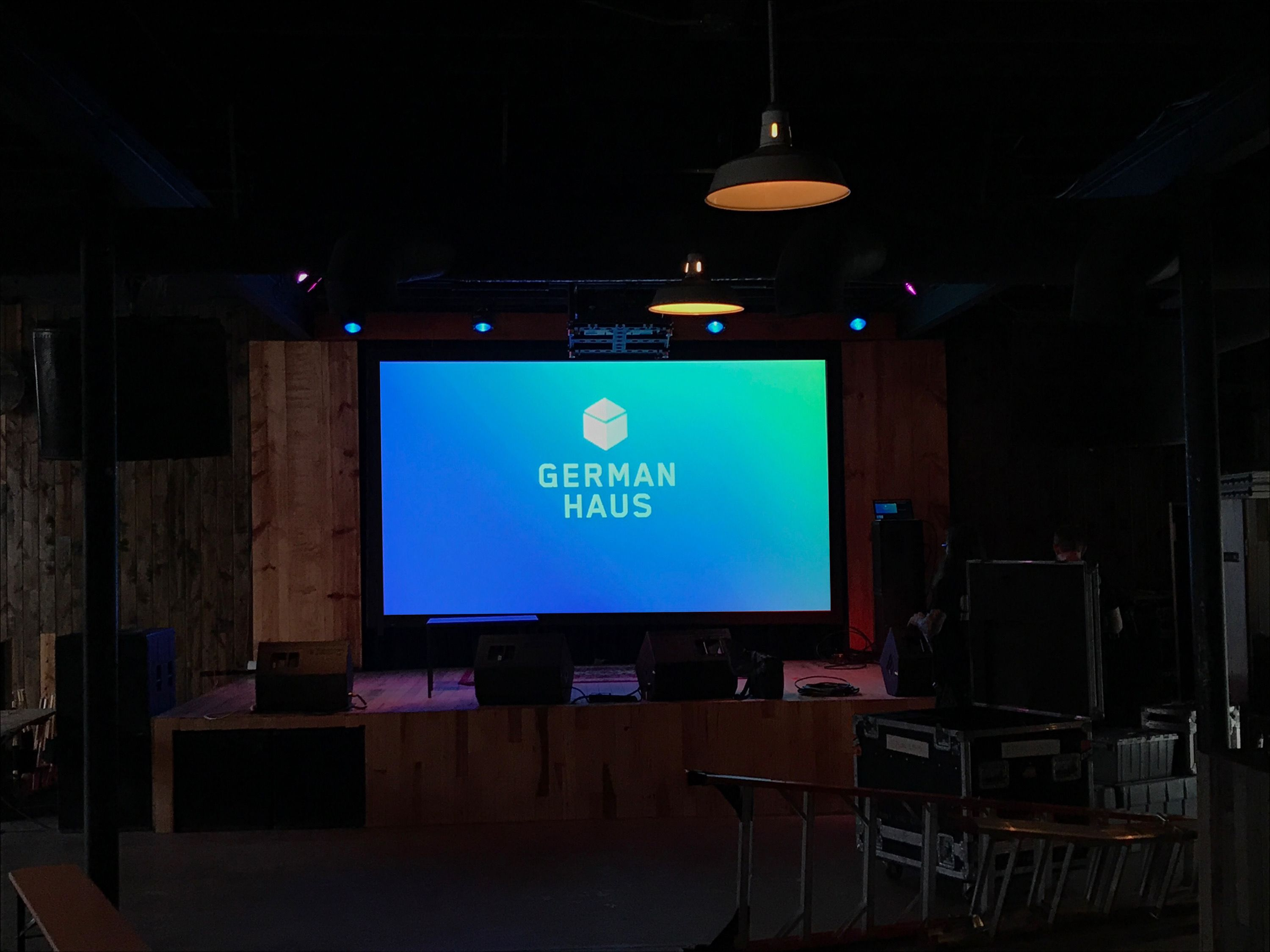 Projection Screen with German Haus Logo Display