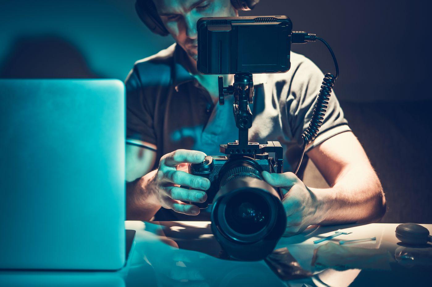 camera-operator-reviewing-video-material-on-displa-TX3U84R.jpeg