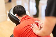 Man-receiving-shiatsu-on-a-quick-massage-chair-1162361810_2125x1416 (1).jpeg
