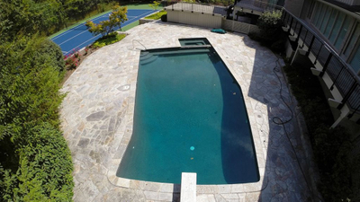 swimming pool renovation, pebble sheen surface finish, slate tile, quartzite pool deck