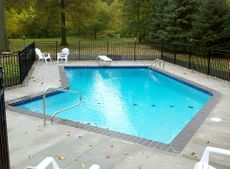 Gunite swimming pool with sapphire blue granite coping.jpg