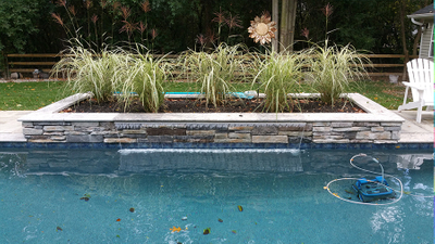 pentair magic falls integrated into raised gunite planter