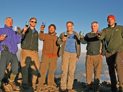 Hikers toast with wine on Agua Volcano.jpg