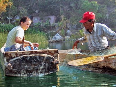 A high school student learns to fish from cayuca.jpg