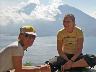 Angela and Anna take a scenic breather during a mountain bike descent to Lake Atitlan.jpg