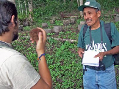 Juan talks eco tourism with a guide at Finca Los Andes near Lake Atitlan, Guatemala.jpg