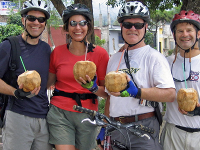 Riders stop for coconut water during a bicycle tour of Antigua Valley.jpg