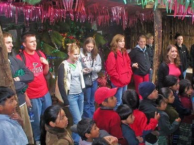 A groupd of high school students joins in the festivities with the local community.jpg