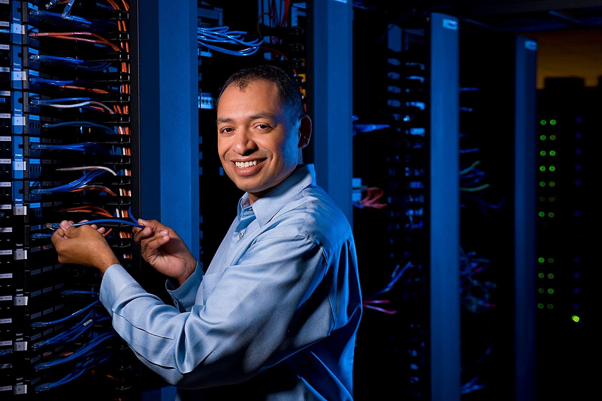 smiling employee working in cherokee data center
