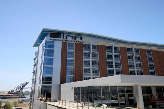 EAST BANK FLATS ALOFT HOTEL