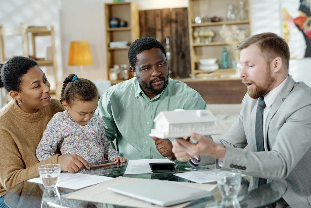 adviser-giving-consultation-on-house-mortgage-2021-04-03-11-53-24-utc.jpg