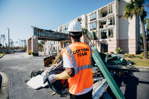 Cotton GDS standing outside damaged hotel in Panama City, FL