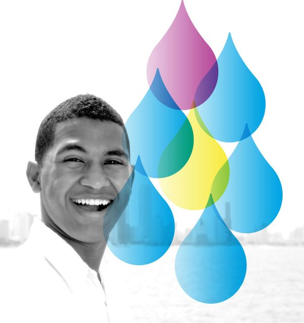 Smiling Young Man with Water Drops Accent from Well Within Logo