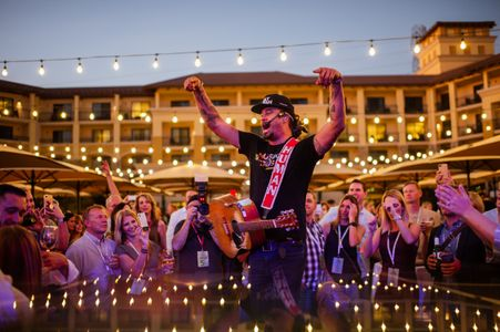 Michael Franti performs for guests at LITV during the Opening Reception at Vista Collina.jpg