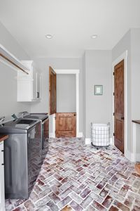 White-washed brick laundry room floor