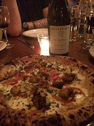 Pizza with Braised Goat, Garroatx, Mozzarella, Herbs and Fennel Pollen