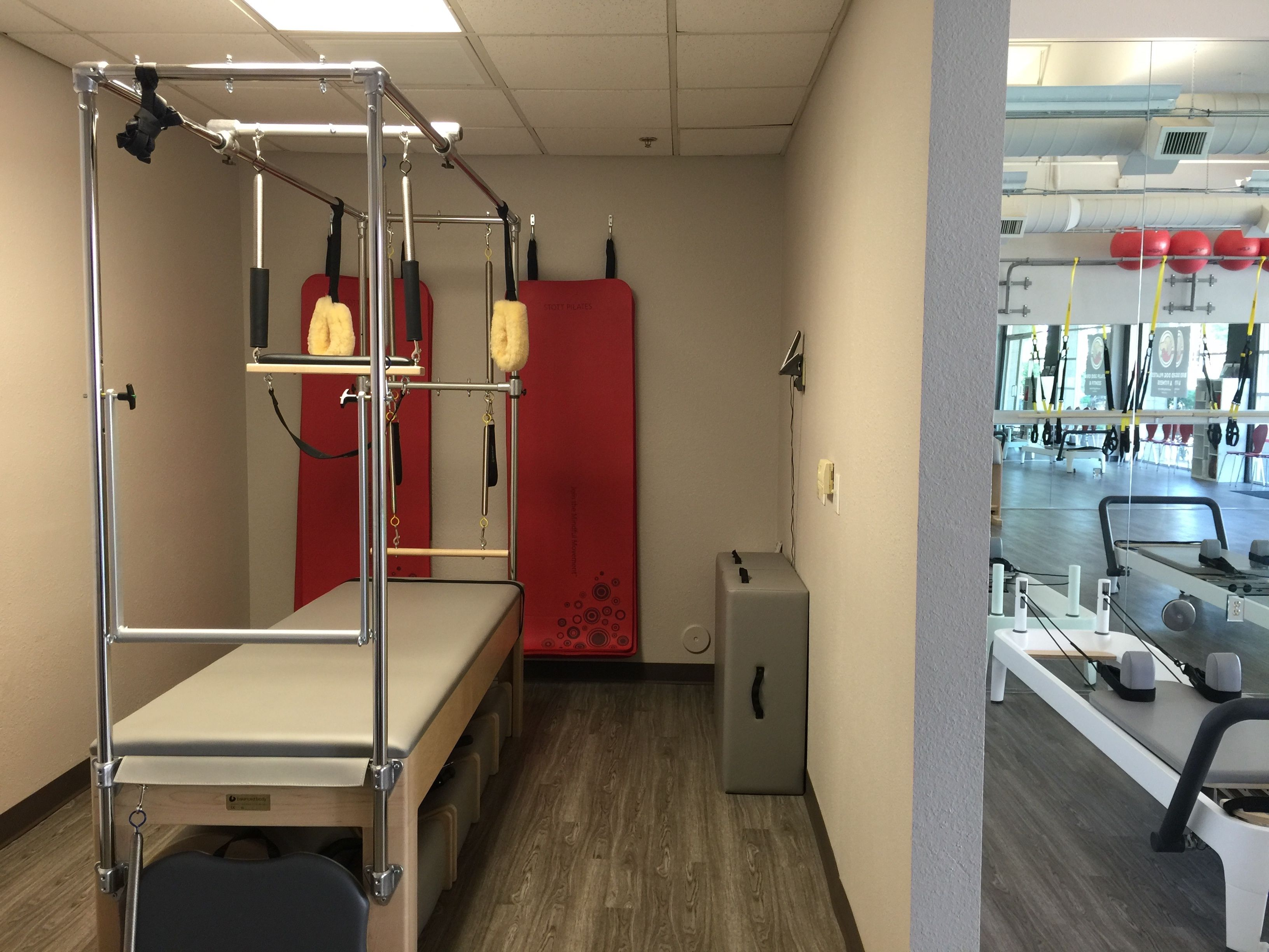 Bird Dog Pilates & Fitness Private Training Space and glimpse of main studio space.