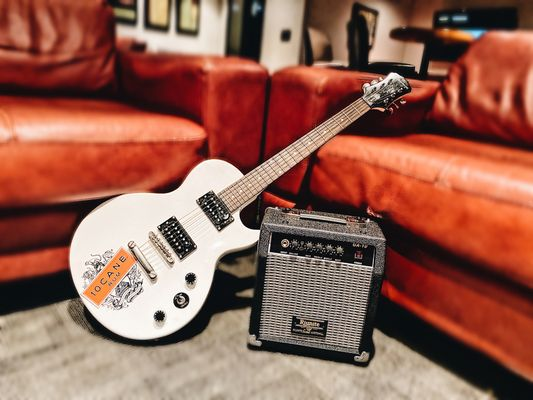 10 Cane Rum Electric Guitar with Amp.JPG