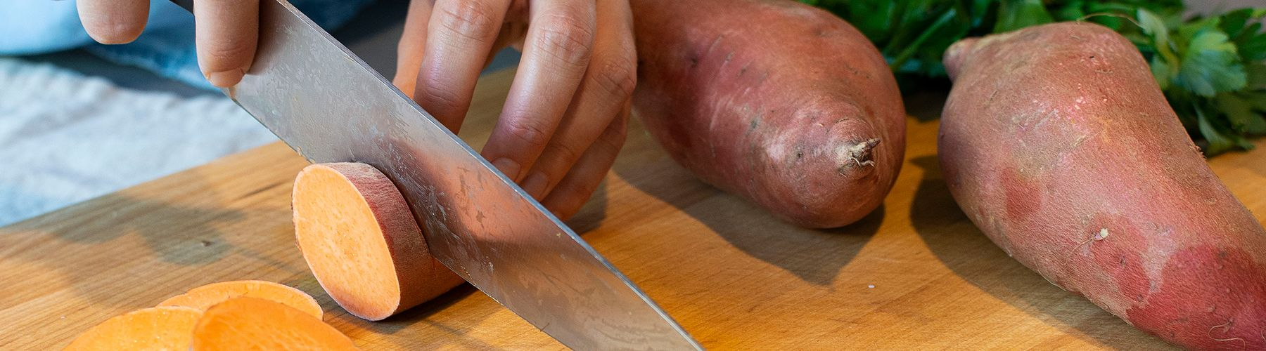 2019-12 Hands Cutting Sweet Potatoes WEBSITE.jpg