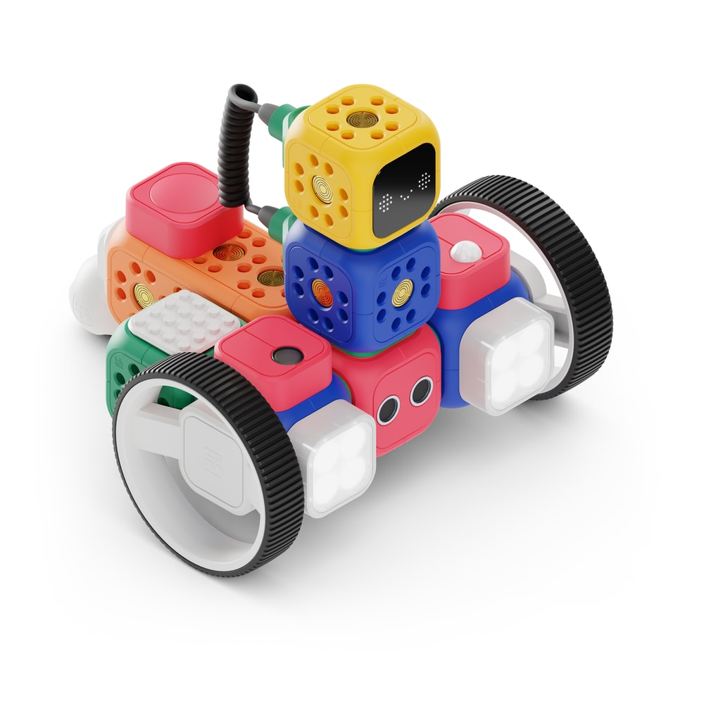 A small robot made of blocks and wheels