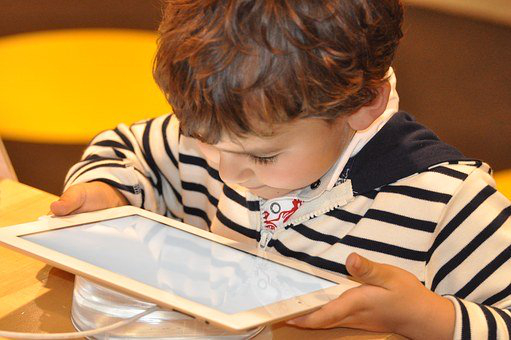 child studying using a tablet
