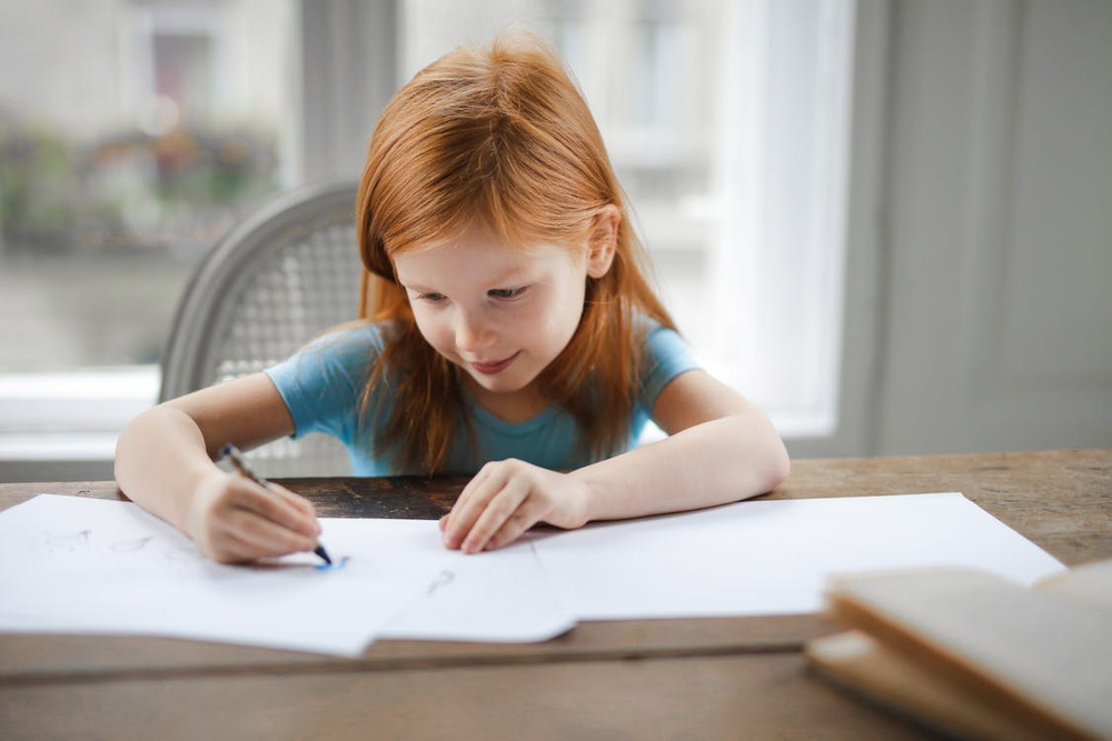 A girl with paper and crayon